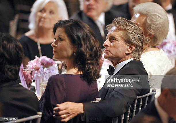 US actor Michael Douglas and his wife Catherin ZetaJones attend a ceremony during which French President Nicolas Sarkozy received the Humanitarian...