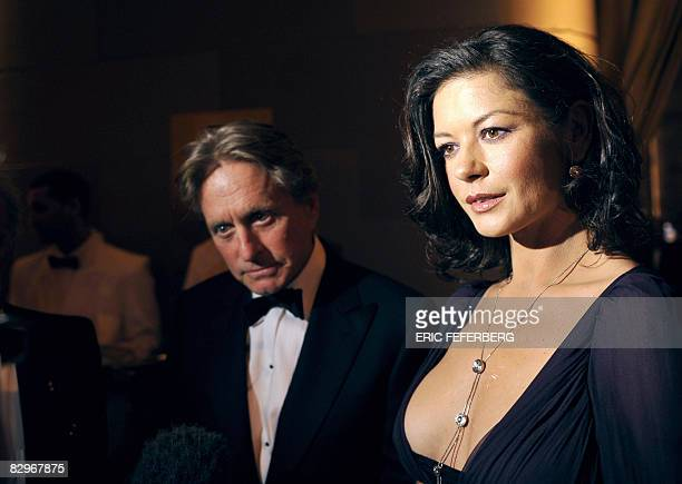 US actor Michael Douglas and his wife Catherine ZetaJones attend a ceremony where French President Nicolas Sarkozy received the Humanitarian Award on...