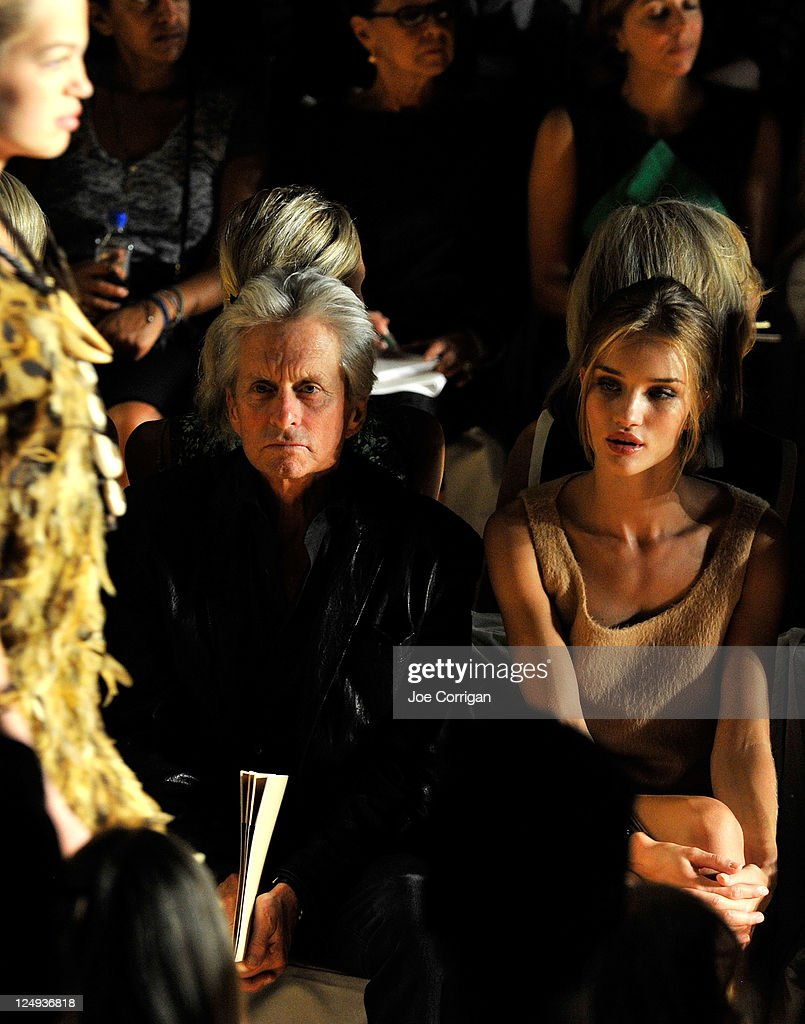 Actor <a gi-track='captionPersonalityLinkClicked' href=/galleries/search?phrase=Michael+Douglas&family=editorial&specificpeople=171111 ng-click='$event.stopPropagation()'>Michael Douglas</a> and model <a gi-track='captionPersonalityLinkClicked' href=/galleries/search?phrase=Rosie+Huntington-Whiteley&family=editorial&specificpeople=2244343 ng-click='$event.stopPropagation()'>Rosie Huntington-Whiteley</a> attend the Michael Kors Spring 2012 fashion show during Mercedes-Benz Fashion Week at The Theater at Lincoln Center on September 14, 2011 in New York City.
