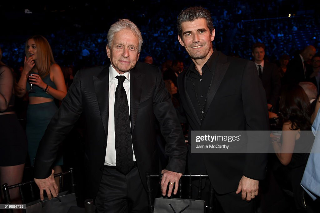 Actor Michael Douglas (L) and President of Rock and Roll Hall of Fame Greg Harris attend the 31st Annual Rock And Roll Hall Of Fame Induction Ceremony at Barclays Center of Brooklyn on April 8, 2016 in New York City.