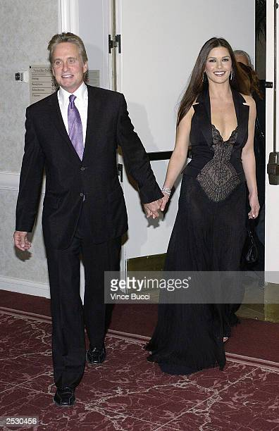 Actor Michael Douglas and wife actress Catherine ZetaJones attend the 3rd Annual AdoptAMinefield Benefit Gala on September 23 2003 at the Beverly...