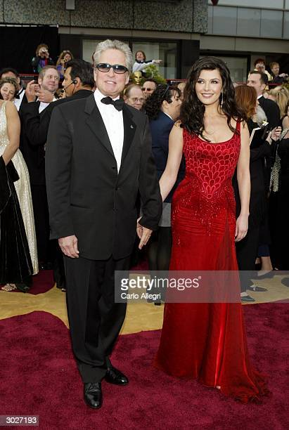 Actor Michael Douglas and wife actress Catherine ZetaJones attend the 76th Annual Academy Awards on February 29 2004 at the Kodak Theater in...