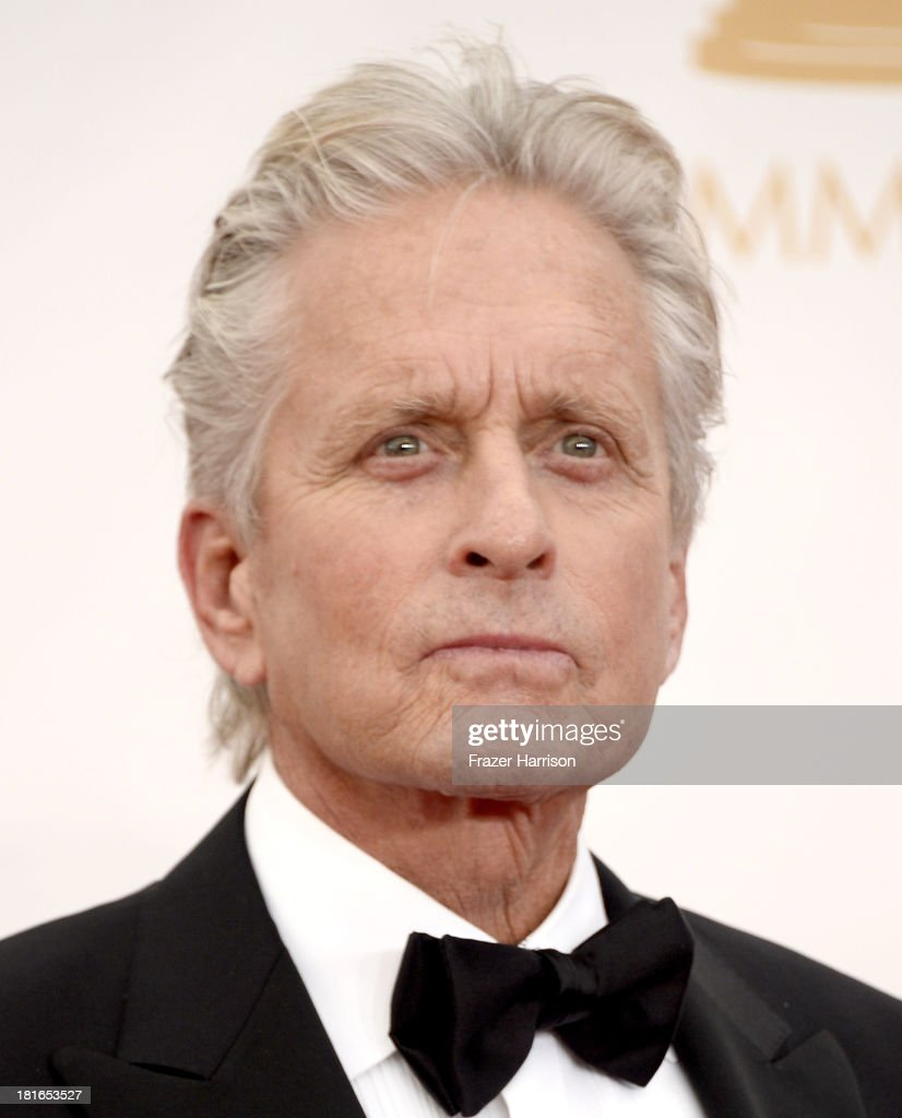 Actor <a gi-track='captionPersonalityLinkClicked' href=/galleries/search?phrase=Michael+Douglas&family=editorial&specificpeople=171111 ng-click='$event.stopPropagation()'>Michael Douglas</a> arrives at the 65th Annual Primetime Emmy Awards held at Nokia Theatre L.A. Live on September 22, 2013 in Los Angeles, California.