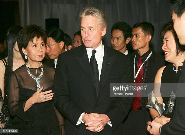 Actor Michael Douglas arrives with JuthamassSiriwan Thai Governor for Tourism at the 2005 Golden Kinnaree Awards for the Bangkok International Film...
