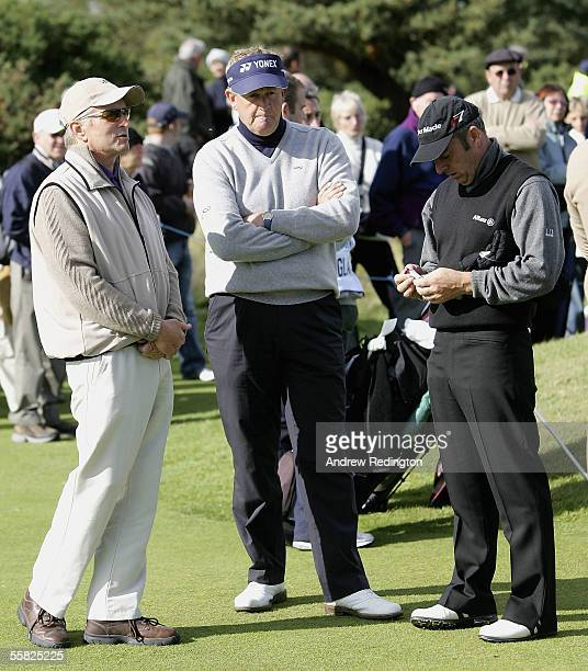 Actor Michael Douglas Colin Montgomerie of Scotland and Paul McGinley of Ireland wait to tee off during the first round of the Dunhill Links...
