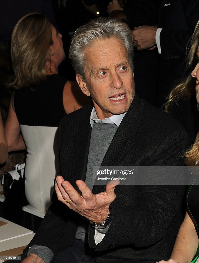 Actor <a gi-track='captionPersonalityLinkClicked' href=/galleries/search?phrase=Michael+Douglas&family=editorial&specificpeople=171111 ng-click='$event.stopPropagation()'>Michael Douglas</a> front row during the Michael Kors Fall 2013 Mercedes-Benz Fashion Show at The Theater at Lincoln Center on February 13, 2013 in New York City.