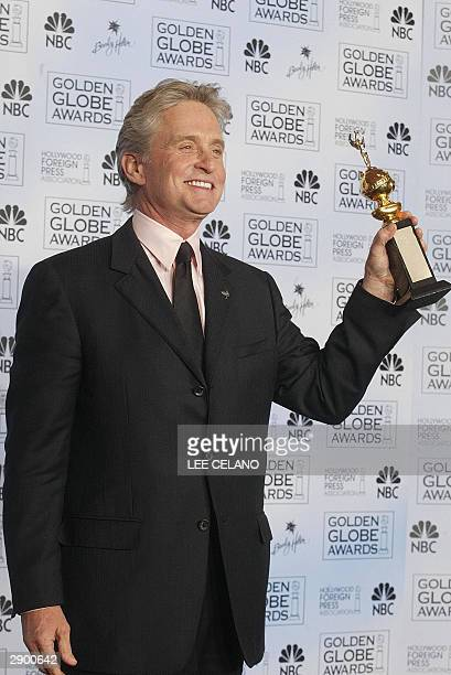 Actor Michael Douglas holds his Cecille B DeMille award at the 61st Golden Globe awards in Beverly Hills California 25 January 2004 AFP PHOTO / Lee...