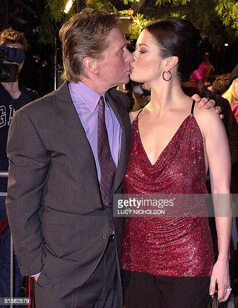 US actor Michael Douglas kisses his newly wed wife Welsh actress Catherine ZetaJones at the premiere of their new film 'Traffic' in Beverly Hills CA...