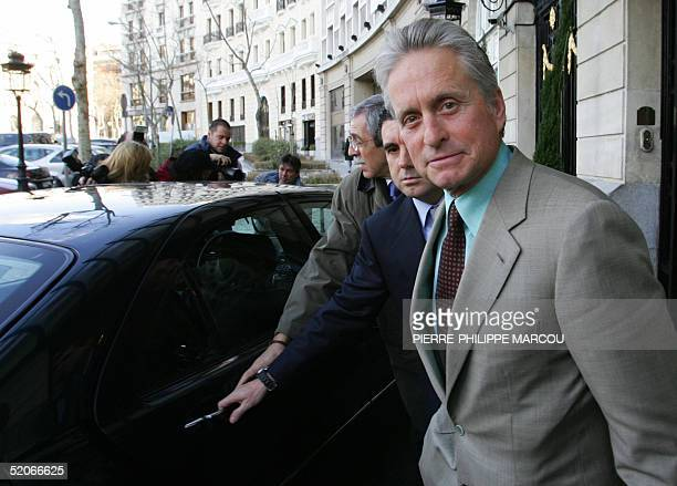US actor Michael Douglas leaves his hotel in Madrid 26 January 2005 en route to the FITUR where he is expected to take part in the 'Day of the...