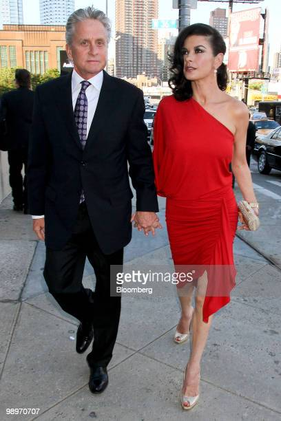 Actor Michael Douglas left and his wife actress Catherine ZetaJones arrive for the Robin Hood Foundation gala in New York US on Monday May 10 2010...