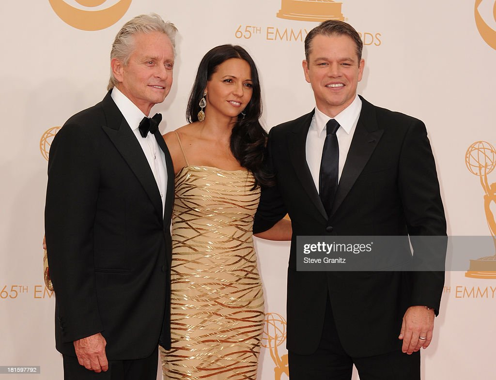Actor Michael Douglas, Luciana Damon and actor Matt Damon arrive at the 65th Annual Primetime Emmy Awards held at Nokia Theatre L.A. Live on September 22, 2013 in Los Angeles, California.