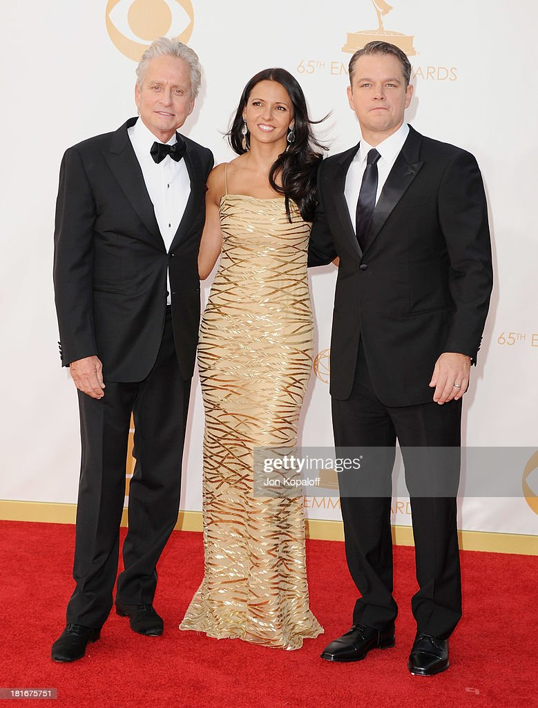 Actor Michael Douglas, Matt Damon (R) and wife Luciana Damon arrive at the 65th Annual Primetime Emmy Awards at Nokia Theatre L.A. Live on September 22, 2013 in Los Angeles, California.