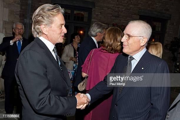 Actor Michael Douglas meets Peter S Kalikow at the Italian Earthquake Relief dinner at Italian Ambassador's Residence on May 20 2009 in Washington DC