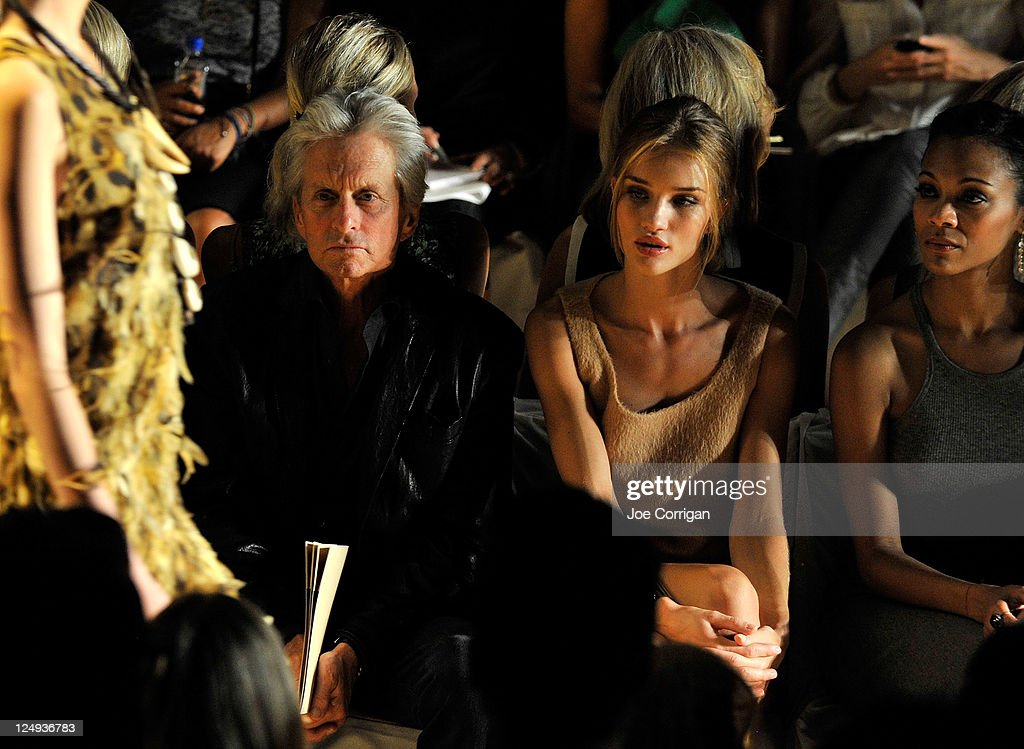 Actor <a gi-track='captionPersonalityLinkClicked' href=/galleries/search?phrase=Michael+Douglas&family=editorial&specificpeople=171111 ng-click='$event.stopPropagation()'>Michael Douglas</a>, model <a gi-track='captionPersonalityLinkClicked' href=/galleries/search?phrase=Rosie+Huntington-Whiteley&family=editorial&specificpeople=2244343 ng-click='$event.stopPropagation()'>Rosie Huntington-Whiteley</a> and actress <a gi-track='captionPersonalityLinkClicked' href=/galleries/search?phrase=Zoe+Saldana&family=editorial&specificpeople=542691 ng-click='$event.stopPropagation()'>Zoe Saldana</a> attend the Michael Kors Spring 2012 fashion show during Mercedes-Benz Fashion Week at The Theater at Lincoln Center on September 14, 2011 in New York City.