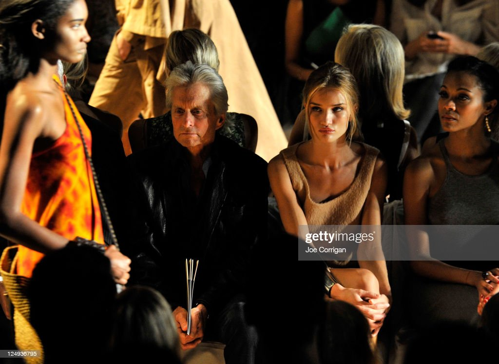 Actor Michael Douglas, model Rosie Huntington-Whiteley and actress Zoe Saldana attend the Michael Kors Spring 2012 fashion show during Mercedes-Benz Fashion Week at The Theater at Lincoln Center on September 14, 2011 in New York City.
