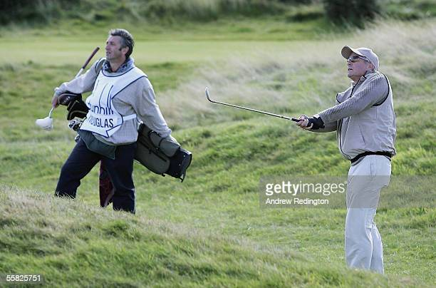 Actor Michael Douglas plays his third shot at the 16th hole during the first round of the Dunhill Links Championships at the Carnoustie Golf Club...