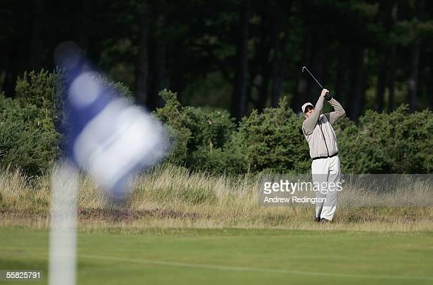 Actor Michael Douglas plays his third shot to the 12th green during the first round of the Dunhill Links Championships at the Carnoustie Golf Club...