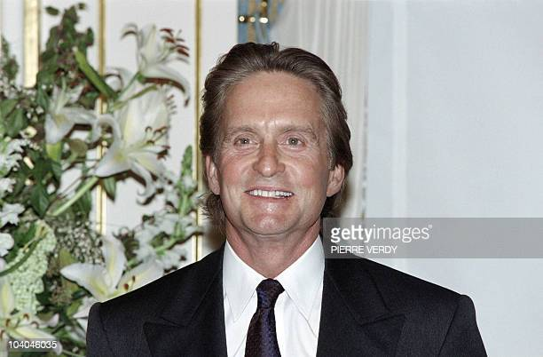 US actor Michael Douglas poses after he was honored Officer of the Order of Arts and Letters on February 27 1998 in Paris AFP PHOTO PIERRE VERDY