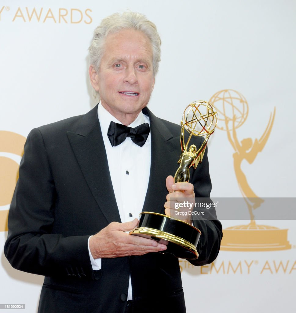Actor <a gi-track='captionPersonalityLinkClicked' href=/galleries/search?phrase=Michael+Douglas&family=editorial&specificpeople=171111 ng-click='$event.stopPropagation()'>Michael Douglas</a> poses in the press room at the 65th Annual Primetime Emmy Awards at Nokia Theatre L.A. Live on September 22, 2013 in Los Angeles, California.