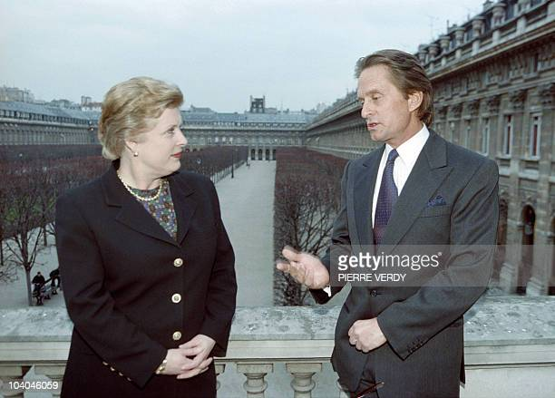 US actor Michael Douglas poses with French Culture minister Catherine Trautmann before he was honored Officer of the Order of Arts and Letters on...