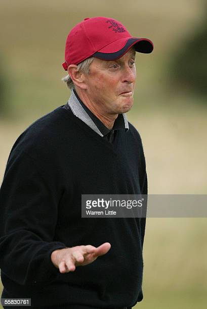 Actor Michael Douglas reacts to his second shot at the 17th hole during the second round of the Dunhill Links Championships on the Old Course...