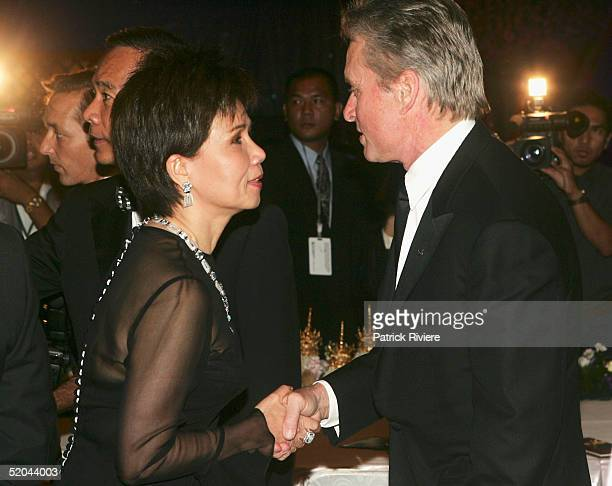 Actor Michael Douglas shakes hand with JuthamassSiriwan Thai Governor for Tourism on arrival at the 2005 Golden Kinnaree Awards for the Bangkok...