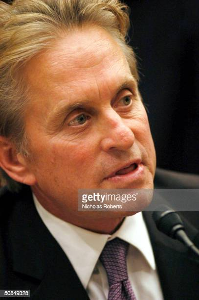 Actor Michael Douglas speaks as a member to a panel discussion about weapons nonproliferation on Capitol Hill in Washington DC on October 2 2003