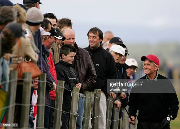 Actor Michael Douglas talks to the crowd on the 16th hole during the second round of the Dunhill Links Championships on the Old Course September 30...