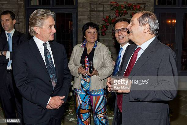 Actor Michael Douglas talks with Amedeo Felisa General Manager and CEO of Ferrari at the Italian Earthquake Relief dinner at Italian Ambassador's...