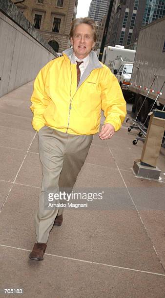 Actor Michael Douglas walks through a movie set March 19 2002 in New York City His new movie 'Smack in the Kisser' also stars his father Curt and son...