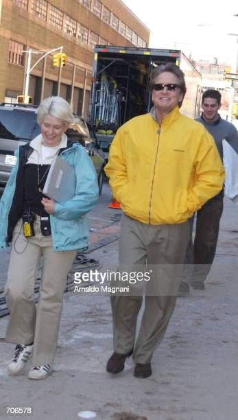 Actor Michael Douglas walks through the movie set for his new film 'Smack in the Kisser' March 21 2002 in New York City The film also stars his...