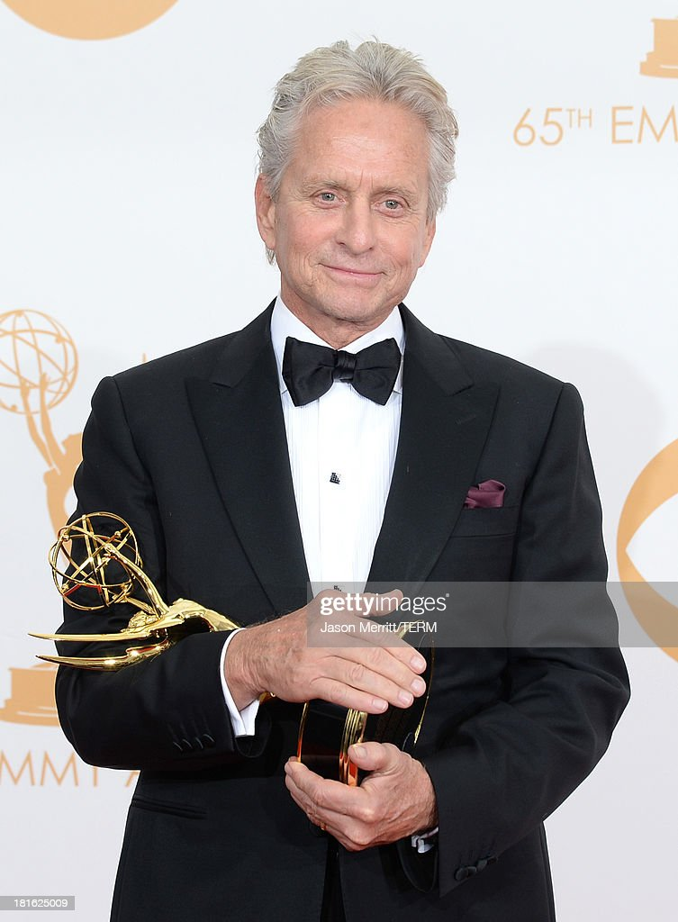 Actor Michael Douglas winner of the Best Lead Actor in a Miniseries or Movie Award for 'Behind The Candelabra' poses in the press room during the...