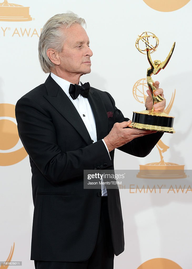 Actor <a gi-track='captionPersonalityLinkClicked' href=/galleries/search?phrase=Michael+Douglas&family=editorial&specificpeople=171111 ng-click='$event.stopPropagation()'>Michael Douglas</a>, winner of the Best Lead Actor in a Miniseries or Movie Award for 'Behind The Candelabra' poses in the press room during the 65th Annual Primetime Emmy Awards held at Nokia Theatre L.A. Live on September 22, 2013 in Los Angeles, California.