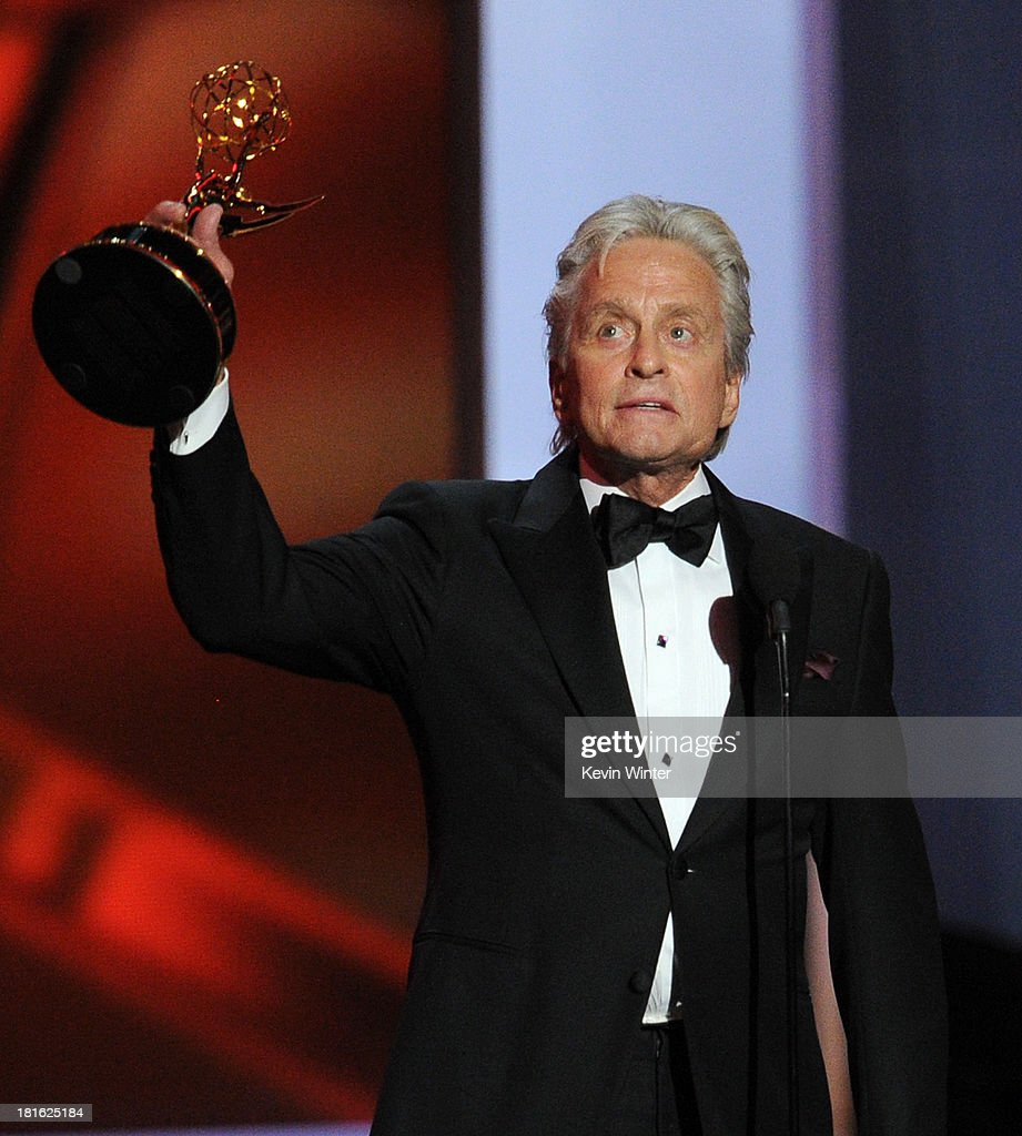 Actor <a gi-track='captionPersonalityLinkClicked' href=/galleries/search?phrase=Michael+Douglas&family=editorial&specificpeople=171111 ng-click='$event.stopPropagation()'>Michael Douglas</a>, winner of the Best Lead Actor in a Miniseries or Movie Award for 'Behind The Candelabra' speaks onstage during the 65th Annual Primetime Emmy Awards held at Nokia Theatre L.A. Live on September 22, 2013 in Los Angeles, California.