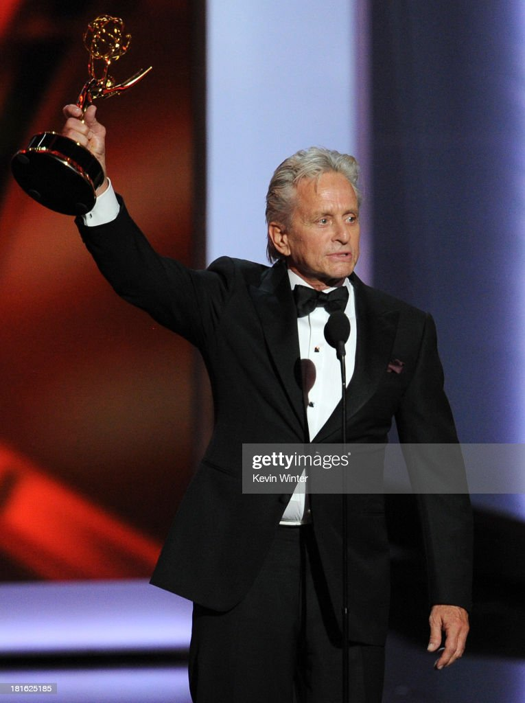 Actor Michael Douglas winner of the Best Lead Actor in a Miniseries or Movie Award for 'Behind The Candelabra' speaks onstage during the 65th Annual...