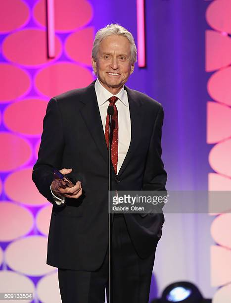 Actor Michael Douglas winner of the Career Acheivement Award speaks onstage at AARP's Movie For GrownUps Awards at the Beverly Wilshire Four Seasons...