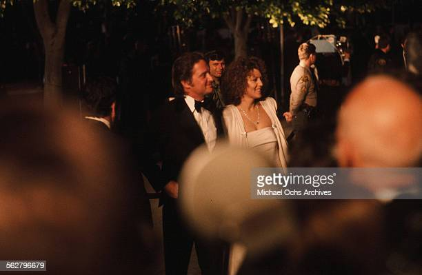 Actor Michael Douglas with actress Brenda Vaccaro arrive to the 48th Academy Awards at Dorothy Chandler Pavilion in Los AngelesCalifornia