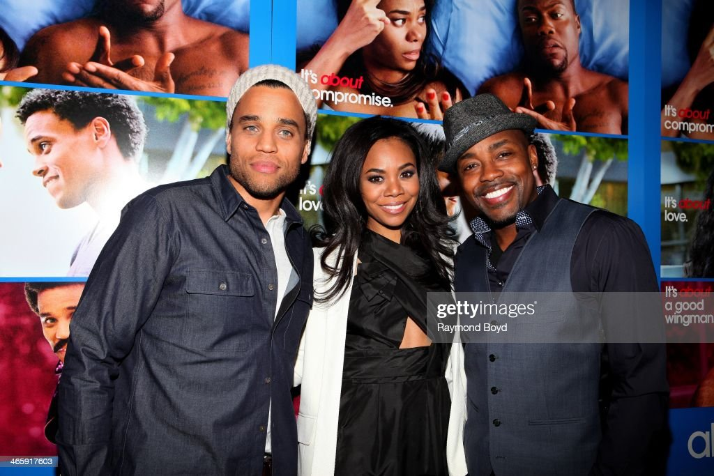 Actor Michael Ealy actress Regina Hall and movie producer Will Packer poses for photos on the red carpet prior to a special screening of their film...