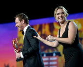 Actor Michael Fassbender accepts the International Star Award from actress Kate Winslet onstage at the 27th Annual Palm Springs International Film...