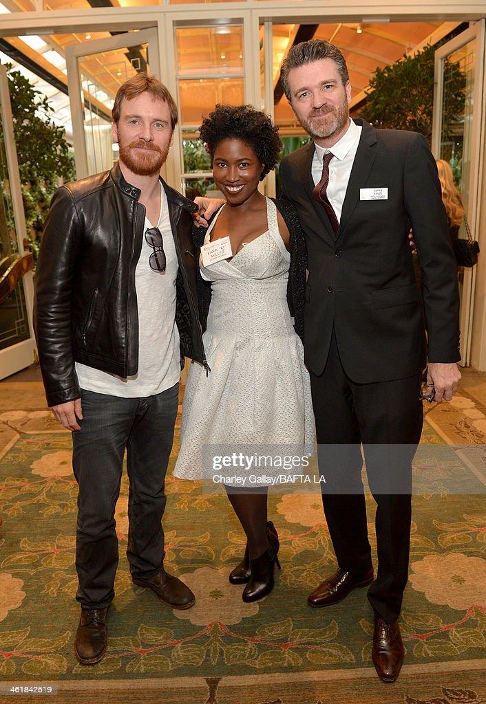 Actor Michael Fassbender and BAFTA board members Kara 'KJ' Miller and James Knight attend the BAFTA LA 2014 Awards Season Tea Party at the Four...
