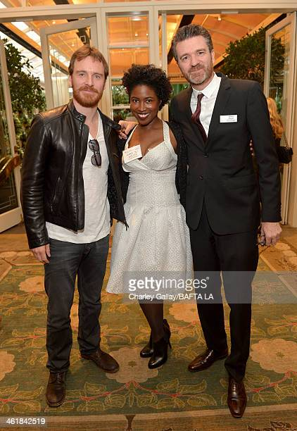 Actor Michael Fassbender and BAFTA board members Kara 'KJ' Miller and James Knight attend the BAFTA LA 2014 Awards Season Tea Party at the Four...