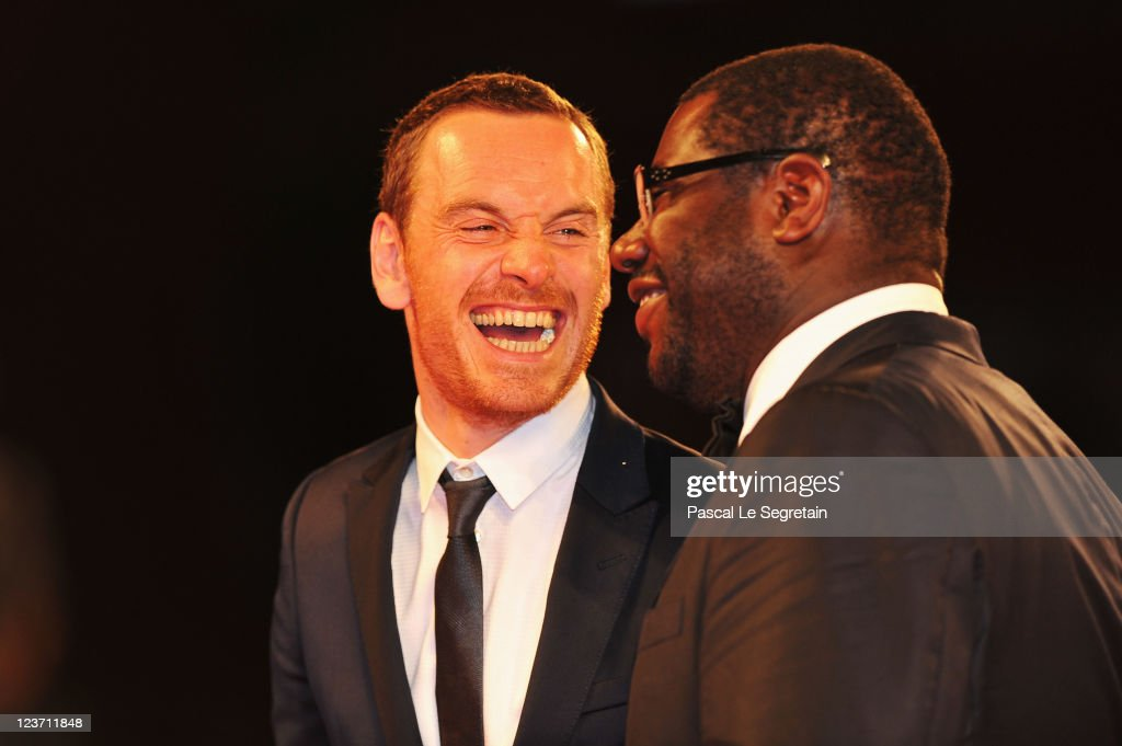 Actor <a gi-track='captionPersonalityLinkClicked' href=/galleries/search?phrase=Michael+Fassbender&family=editorial&specificpeople=4157925 ng-click='$event.stopPropagation()'>Michael Fassbender</a> and director Steve McQueenn attend the 'Shame' premiere during the 68th Venice Film Festival at Palazzo del Cinema on September 4, 2011 in Venice, Italy.
