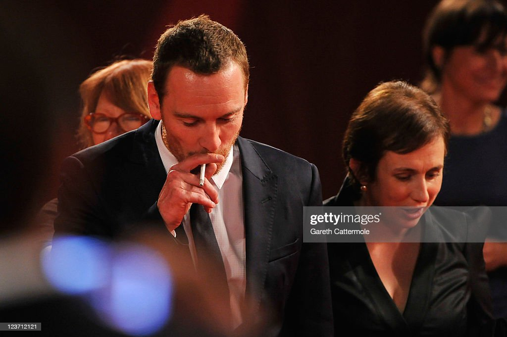 Actor <a gi-track='captionPersonalityLinkClicked' href=/galleries/search?phrase=Michael+Fassbender&family=editorial&specificpeople=4157925 ng-click='$event.stopPropagation()'>Michael Fassbender</a> and screenwriter Abi Morgan attend the 'Shame' premiere during the 68th Venice Film Festival at Palazzo del Cinema on September 4, 2011 in Venice, Italy.