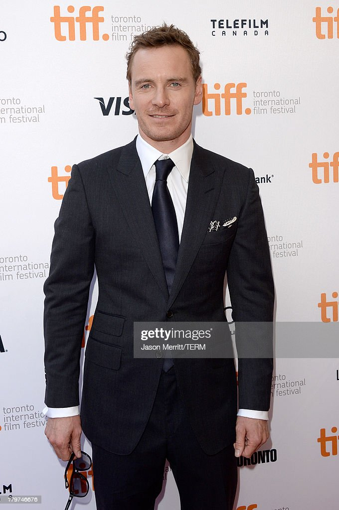Actor <a gi-track='captionPersonalityLinkClicked' href=/galleries/search?phrase=Michael+Fassbender&family=editorial&specificpeople=4157925 ng-click='$event.stopPropagation()'>Michael Fassbender</a> arrives at the '12 Years A Slave' premiere during the 2013 Toronto International Film Festival at the Princess of Wales Theatre on September 6, 2013 in Toronto, Canada.