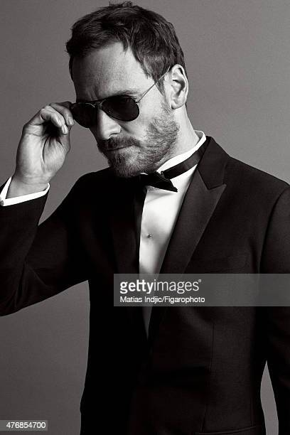 Actor Michael Fassbender is photographed for Madame Figaro on May 18 2015 at the Cannes Film Festival in Cannes France Suit shirt and bow tie...