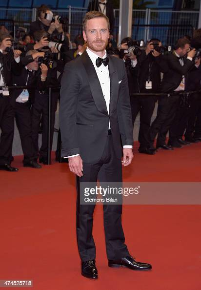 Actor Michael Fassbender leaves the 'Macbeth' Premiere during the 68th annual Cannes Film Festival on May 23 2015 in Cannes France