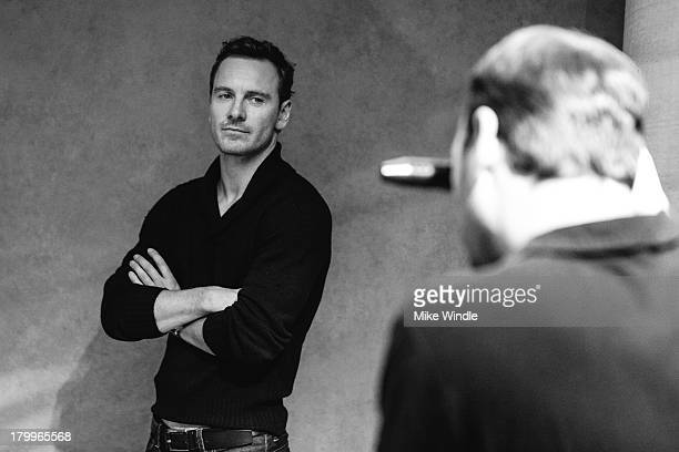 Actor Michael Fassbender poses for a portrait with photographer Jeff Vespa during the 2013 Toronto International Film Festival on September 7 2013 in...