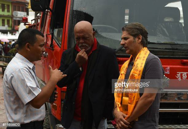 US actor Michael Imperioli star of TV series 'The Sopranos' and Nepali Bollywood star Sunil Thapa talk with Nepali fire chief Kishor Kumar Bhattarai...