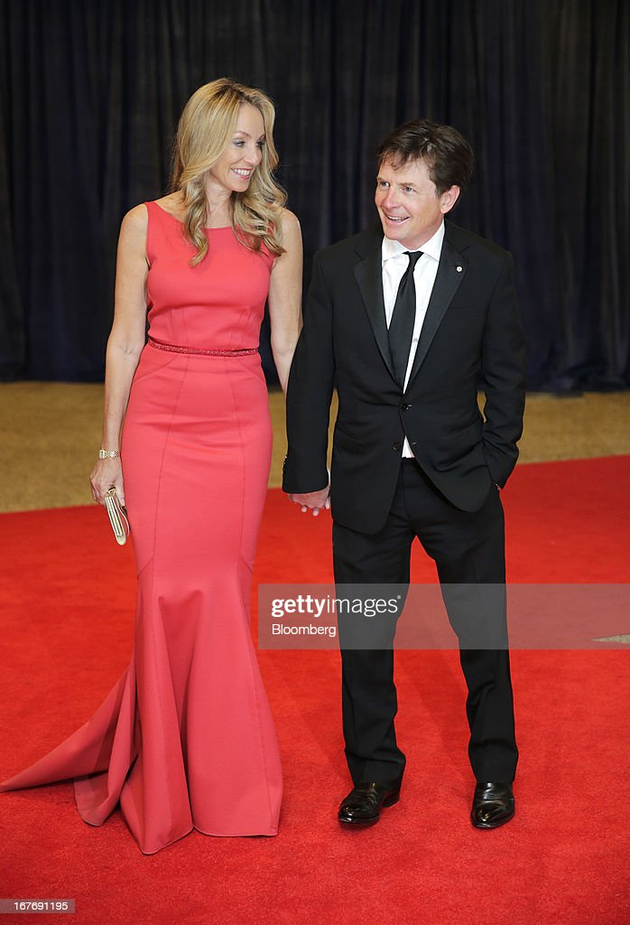 Actor Michael J. Fox and wife actress Tracy Pollan arrive for the White House Correspondents' Association (WHCA) dinner in Washington, D.C., U.S., on Saturday, April 27, 2013. The 99th annual dinner raises money for WHCA scholarships and honors the recipients of the organization's journalism awards. Photographer: Scott Eells/Bloomberg via Getty Images
