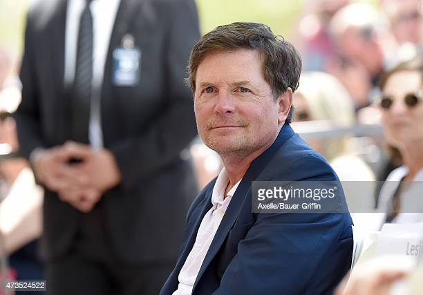 Actor Michael J Fox attends the ceremony honoring Julianna Margulies with a star on the Hollywood Walk of Fame on May 1 2015 in Hollywood California